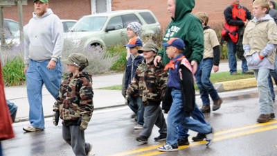 The Boy Scouts troop proudly marches down Oden Street at the PumpkinFest Grand Feature Parade.