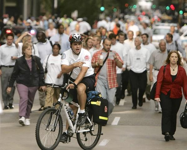 A paramedic rides his bike during a 2006 evacuation drill in Chicago. Purdue University's Homeland Security Institute has studied options for transportation and shelter for displaced people during a nuclear disaster.