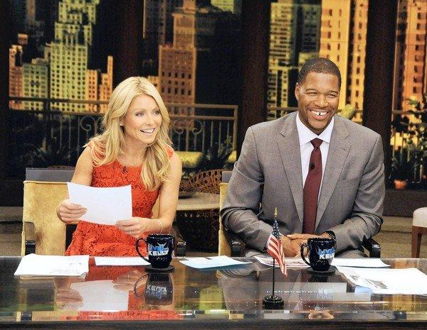 "Former football player Michael Strahan and host Kelly Ripa during Strahan's guest-host appearance on ""Live! With Kelly"" earlier this year."