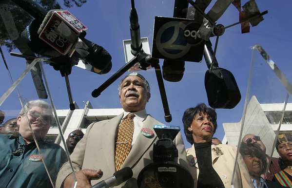 Assemblyman Mervyn Dymally (D-Compton) and Rep.  Maxine Waters (D-Los Angeles) stand together in a news conference in 2004.