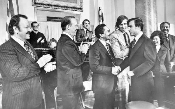Jerry Brown shakes hands with Lt. Gov. Mervyn Dymally before being sworn in as governor in 1975.