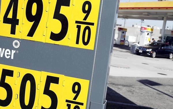 The average price for a gallon of regular gasoline in California hit a record high of $4.655 on Sunday, according to the AAA Fuel Gauge Report. The national average was at $3.814. Above, the price of premium unleaded gasoline tops $5 per gallon at a Shell station along Washington Boulevard in downtown Los Angeles.