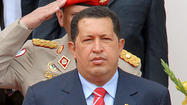 Venezuelan President Hugo Chavez was re-elected Sunday to a new six-year term, overcoming an energetic challenge by a candidate backed by an opposition coalition, according to nearly complete results announced by election officials.
