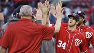 ST. LOUIS -- The Washington Nationals were so impressed with outfielder Tyler Moore as an amateur that they drafted him three times before he finally signed. On Sunday, that persistence paid off in the opening game of the NL Division Series.
