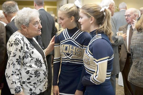 Mary Noto Miller, of Bethlehem, class of '44, talks with Notre Dame cheerleaders Sara Prager (center) and Alexis Sherman (right), both 16 of Bethlehem, during the 100th reunion for graduates of the former Easton Catholic High School held at the Green Pond Country Club on Sunday.