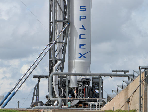 A Falcon 9 rocket poised for historic launch from Cape Canaveral Air Force Station.