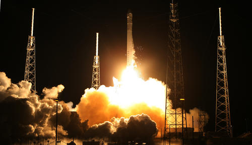 A Falcon 9 rocket carrying a Dragon blasts off on a historic launch from Cape Canaveral Air Force Station.
