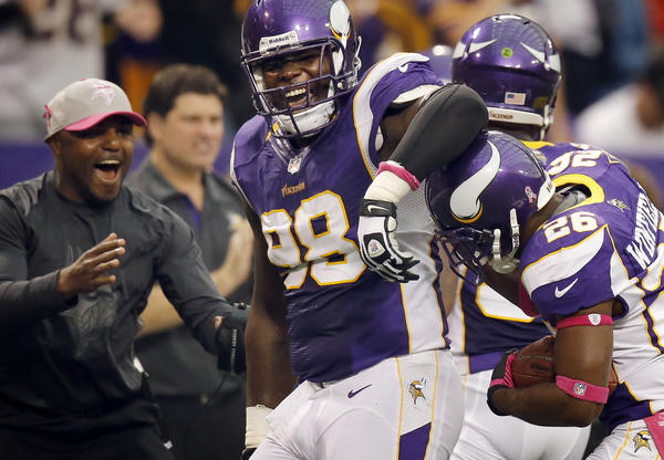 Minnesota Vikings Letroy Guion (98) celebrated with Antoine Winfield (26) after his interception the second quarter at Mall of America Field in Minneapolis, Minnesota, Sunday, October 7, 2012. The Minnesota Vikings defeated the Tennessee Titans, 30-7. (Carlos Gonzalez/Minneapolis Star Tribune/MCT)