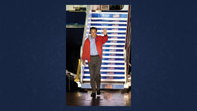 Republican presidential candidate, former Massachusetts Gov. Mitt Romney, waves towards a camera platform after exiting his MD-83 campaign plane at the Shenandoah Valley Regional Airport Sunday evening in Weyers Cave, Va. Romney completed a three day campaign swing through Florida and will deliver a foreign policy address at the Virginia Military Institute in Lexington Monday.