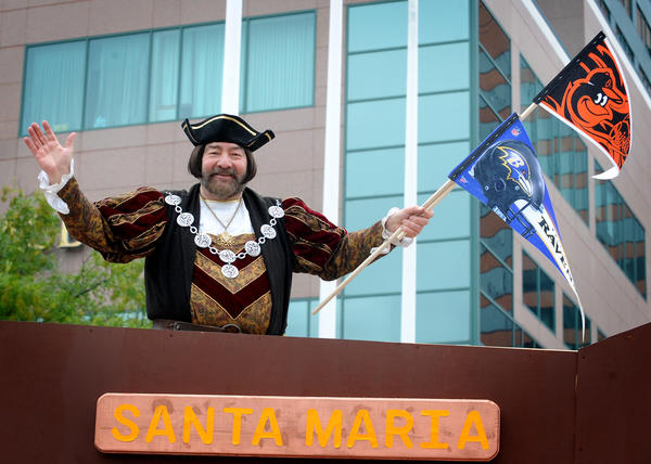 Christopher Columbus (portrayed by Don Castronova) gets into the local teams spirit at the Columbus Day Parade Sunday. He's riding in the Santa Maria boat float made by the Order Sons of Italy in America, Little Italy Lodge #2286,  from Baltimore.