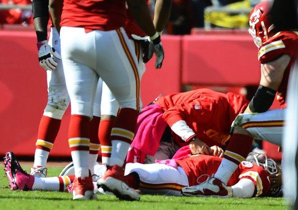Kansas City Chiefs quarterback Matt Cassel lies on the ground after getting injured Sunday.
