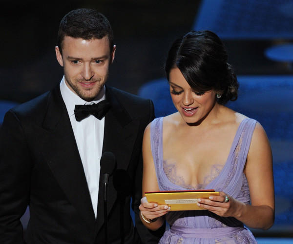 Presenters Justin Timberlake and Mila Kunis speak onstage during the 83rd Annual Academy Awards on Feb. 27, 2011 in Hollywood, Ca.