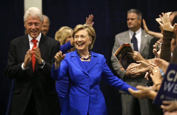 Sen. Hillary Rodham Clinton, D-N.Y. is followed by her husband, former President Bill Clinton, left, while entering a campaign rally in downtown Scranton, Pa., Sunday, Oct. 12, 2008 with Democratic vice presidential candidate, Sen. Joe Biden, D-Del. and his wife Jill Biden.