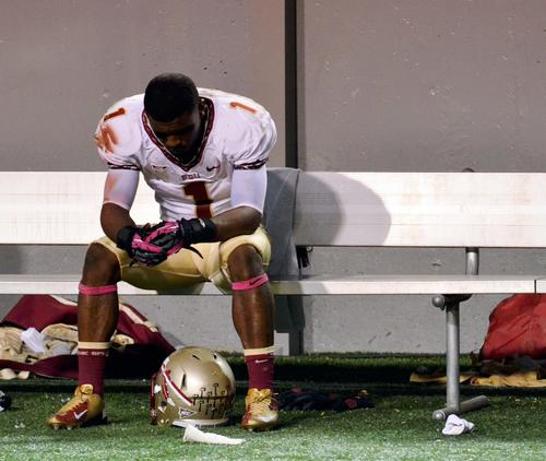 Oct 6, 2012 Raleigh, NC, USA; Florida State Seminoles receiver Kelvin Benjamin (1) sits alone on the bench after a loss to the North Carolina State Wolfpack at Carter-Finley Stadium. North Carolina State won 17-16.