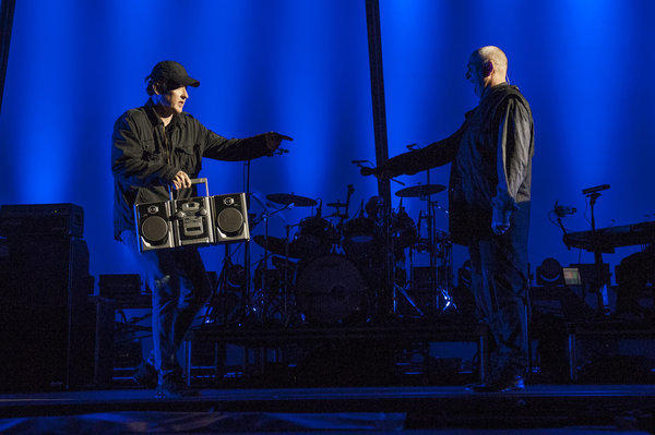 "John Cusack brings a boombox to Peter Gabriel on Oct. 6 at the Hollywood Bowl for the song ""In Your Eyes."""