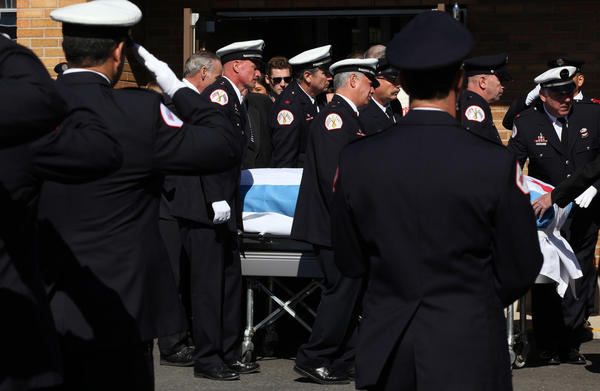 Members of the Chicago Fire Department honor their fellow firefighter Thomas Flahive who died of West Nile Virus.