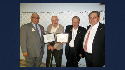 Everett Nicklow (second from left) of Berlin was recognized with a Ross F. DiMarco Fellowship award during a Berlin Lions Club's dinner at New Hope Church Wednesday. Robert E. Rafail (far left), past district governor, and Jim Ott (far right), second vice district governor, both of District 14-M, presented the award, while Paul Smith, a Berlin Lions member, helped coordinate the award locally.