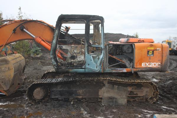 The Anchorage Fire Department says this excavator at Titan Topsoil in South Anchorage received $50,000 to $75,000 in damage from an arson fire in its operator's cab Thursday. Firefighters ask anyone with information on the fire to call Crime Stoppers at 561-STOP.