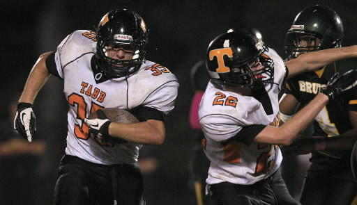 Tabb's Jake Brown, left, has played a role in putting the Tigers in playoff contention.