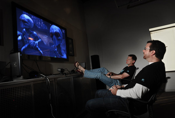 Firaxis Games president and studio head Steve Martin, left, watches as lead producer Garth DeAngelis, right, plays XCOM: Enemy Unknown at the company's Sparks, Md., headquarter. On Tuesday Firaxis Games will be releasing XCOM: Enemy Unknown, a strategy game for Xbox360, PlayStation 3 and PC...