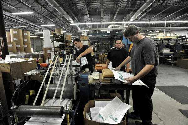 Left to right, Mike Hartsock, Marcus Staines and Bill Taylor work on a job in the H.G. Roebuck & Son Inc. printing facility.