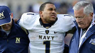 Navy quarterback Trey Miller was held out of practice Monday after sustaining an ankle injury in Saturday's 28-21 overtime win at Air Force. With his left foot in a boot, Miller watched as freshman Keenan Reynolds ran most of the drills in preparation of Friday's game at Central Michigan.