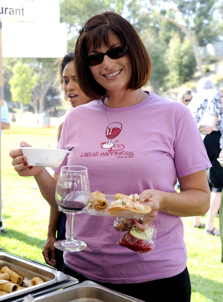 La Canada resident Olivia Brown samples gourmet food and wine during the La Canada Flintridge 10th Annual Wine and Gourmet Food Tasting  at Memorial Park on Sunday, Oct. 7, 2012 in La Canada, Calif.