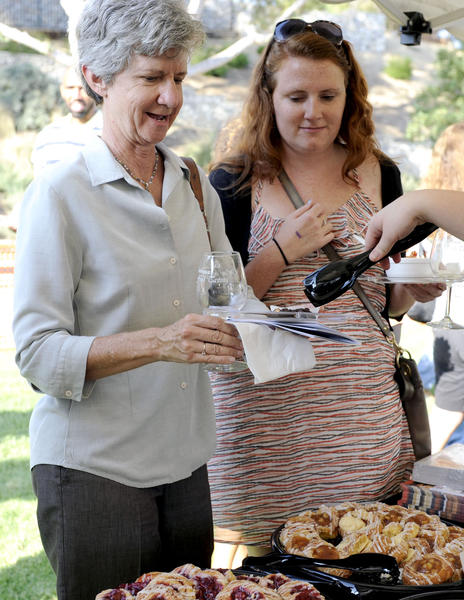 La Canada residents Judy Trumbo and daughter Sarah Vine sample gourmet food from Panera Bread of La Canada during the La Canada Flintridge 10th Annual Wine and Gourmet Food Tasting at Memorial Park on Sunday, Oct. 7, 2012 in La Canada, Calif.
