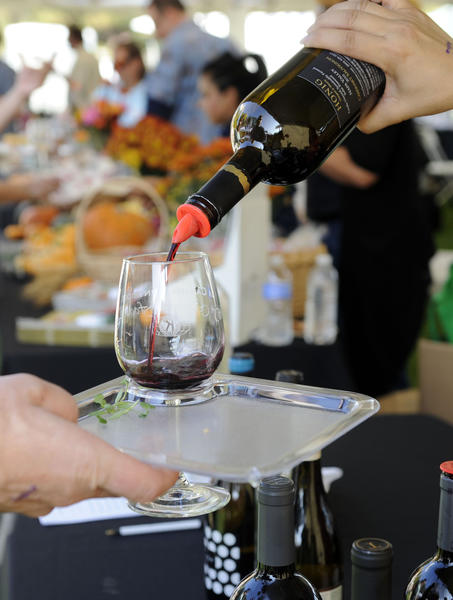 Guests sample gourmet food and wines during the La Canada Flintridge 10th Annual Wine and Gourmet Food Tasting at Memorial Park on Sunday, Oct. 7, 2012 in La Canada, Calif.
