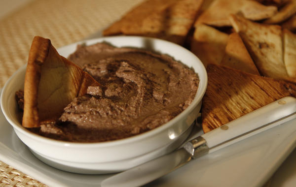 "Move beyond standard hummus with this variation on the classic dip. Blend together black beans and chickpeas with garlic, lemon and tahini paste, and spice it  with a little cayenne and cumin powder. This dip can be made up to a few days in advance. <a href=""http://www.latimes.com/features/food/la-fo-sos-blackbeanhummus-20101028,0,2090370.story"">Click here for the recipe.</a>"