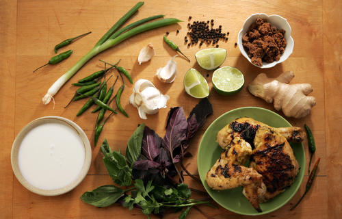 "Fix a fresh marinade with notes of garlic, ginger, cilantro, basil, lemongrass, lime, brown sugar and coconut milk and combine with fresh chicken in a sealable bag. Marinate up to 24 hours before grilling. <a href=""http://www.latimes.com/features/food/la-fo-marinadesrec6c-2009may06,0,1328186.story"">Click here for the recipe.</a>"