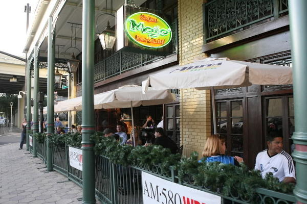 Patrons enjoy Mojo Cajun Bar & Grill restaurant on Church Street before an Orlando Magic game.
