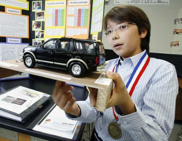 Raymond Gilmartin, at South Pasadena Middle School in April  2012, shows how he was able to calculate the drag differences between spoilers on a model SUV to win the Sweepstakes Prize at the 2012 Los Angeles County Science Fair. He won a national honor in the Broadcom Masters in October 2012.