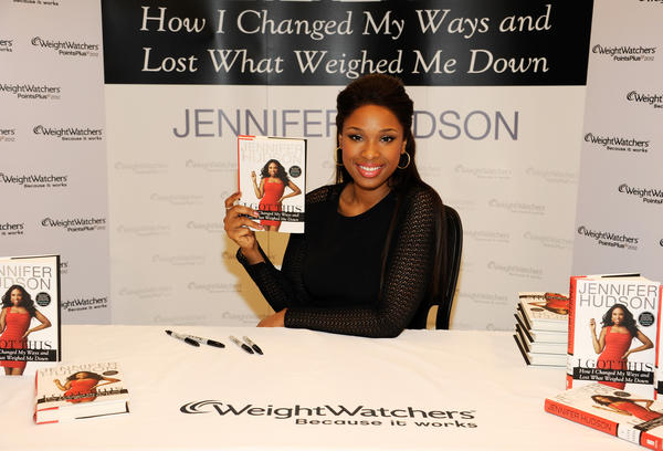 "Academy Award-winning actress and Grammy Award-winning recording artist Jennifer Hudson autographs copies of her new memoir, ""I Got This,"" at a New York Weight Watchers center where hundreds of fans got the chance to meet her on January 11, 2012 in New York City."