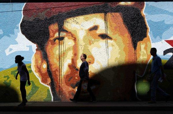 A mural in Caracas, Venezuela, depicts President Hugo Chavez, who won reelection to a third six-year term.