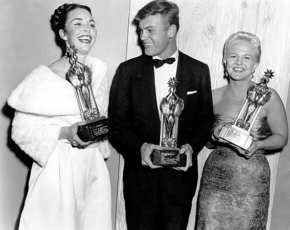"Jennifer Jones, Tab Hunter and singer-actress Peggy Lee present their trophies at the Audience Awards poll in Hollywood, on Dec. 6, 1955.  Jones won in the best performance category for her role in ""Love Is a Many Splendored Thing.""  Hunter was named promising new male personality; and Lee was named promising new actress."