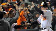 "For the second consecutive night, Orioles fans streamed into Camden Yards wearing their orange, twirling their ""BUCKle Up"" towels and surviving a first-pitch rain delay in hopes their Orioles could beat the bullies of the American League East."