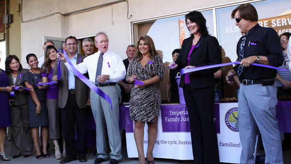 Gina Vargas (center), a representative of Sen. Juan Vargas, 40th District, celebrates with dignitaries and guests after cutting the ribbon to the Family Justice Center on Monday in El Centro.