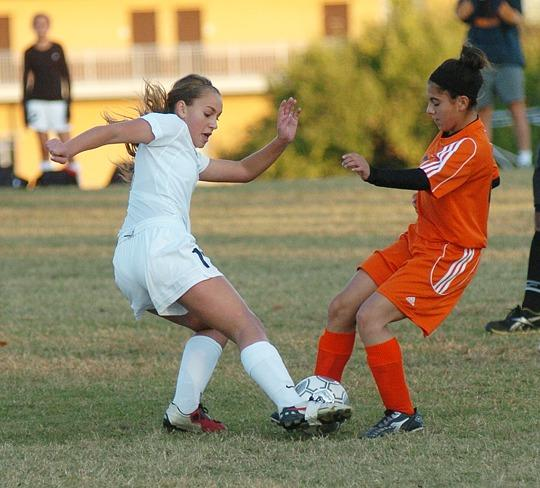 George Rogers Clark's Catie Curren battles a Paris player for possession of the ball Monday night in Paris.