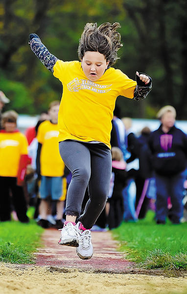 Brianna Gladfelter, 9, a student at Summitview  Elementary school, competes in the long jump Monday during a  track meet for elementary school students in the Waynesboro (Pa.) Area School District at at Indian Stadium on the campus of Waynesboro Area Senior High School.