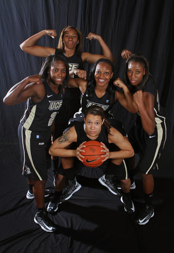 Members of the UCF women's basketball team strike a pose during UCF men's and women's basketball media day on October 8, 2012.