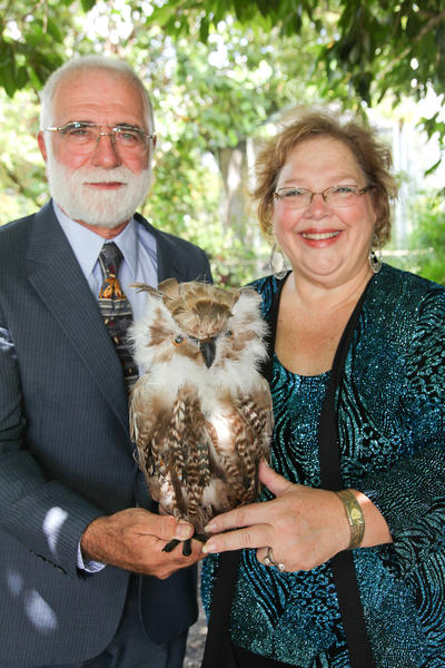 "Steve Konash, left, and Beth Konash hold an owl that can be found at the Sawgrass Nature Center & Wildlife Hospital. Proceeds from the ""Feather & Fur Ball,"" which will take place on Nov. 3 at the Woodmont Country Club located in Tamarac, will be used to support feathery friends such as the owl."