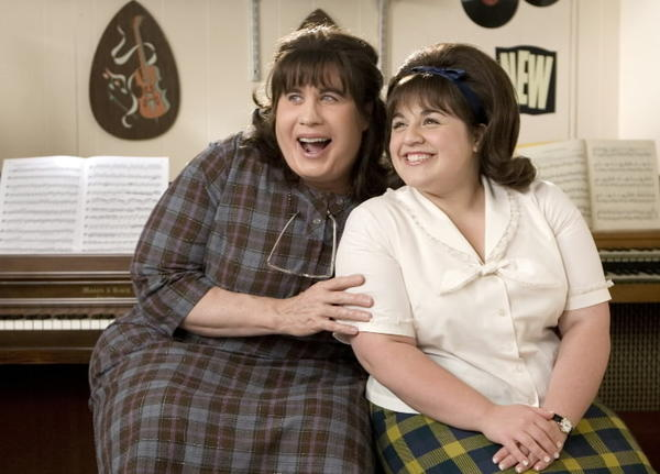 "John Travolta as Edna Turnblad (left) in ""Hairspray."" Nikki Blonsky as Tracy Turnblad (right)."