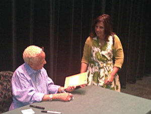 Fan shows Nikki Giovanni treasured book of her poetry
