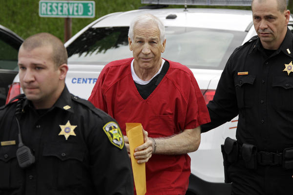 Former Penn State University assistant football coach Jerry Sandusky, center,  arrives for sentencing at the Centre County Courthouse in Bellefonte, Pa., Tuesday. Sandusky was convicted of sexually abusing 10 boys in a scandal that rocked the university and brought down Hall of Fame coach Joe Paterno.
