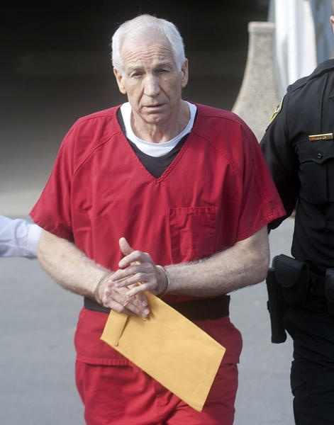 Jerry Sandusky leaves the Centre County Courthouse in Bellefonte after being handed a 30-60 year sentence on Tuesday, October 9, 2012.