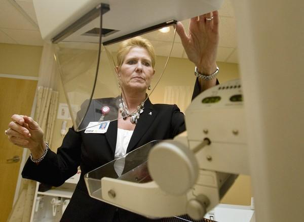 Lisa Bowles demonstrates the functions of a Hologic Lorad Selenia, a digital mammography machine used at Sentara's Dorothy G. Hoefer Comprehensive Breast Center in Newport News.