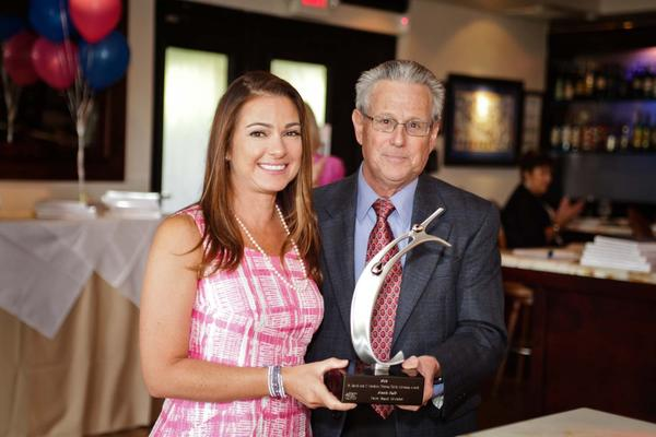 "Annie Falk, left, and Barry Krischer at Children's Home Society of Florida's ""Child Advocate of the Year Luncheon,"" which took place on Sept. 25 at Cafe Sapori located in West Palm Beach. Falk was honored with the R. David and I. Lorraine Thomas Child Advocate of the Year Award. To see more photos from Society Scene's Palm Beach edition, visit www.Facebook.com/SocietyScene."
