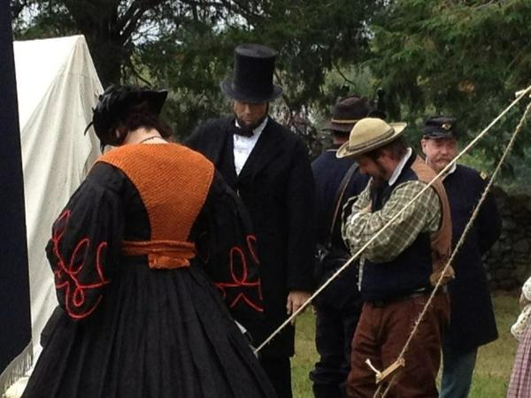 Participants dress in period clothing at a Civil War reenactment in Wickham Park.