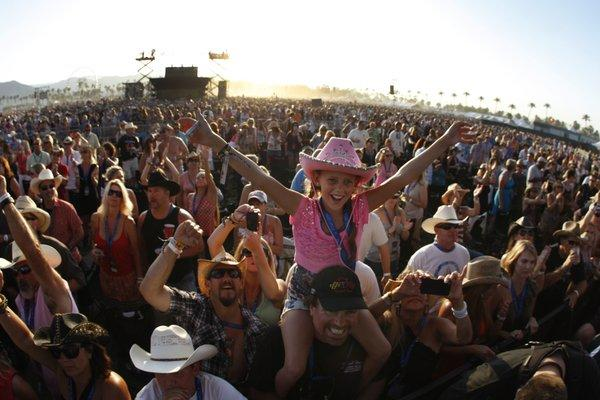 A young fan celebrates at Stagecoach in 2012.